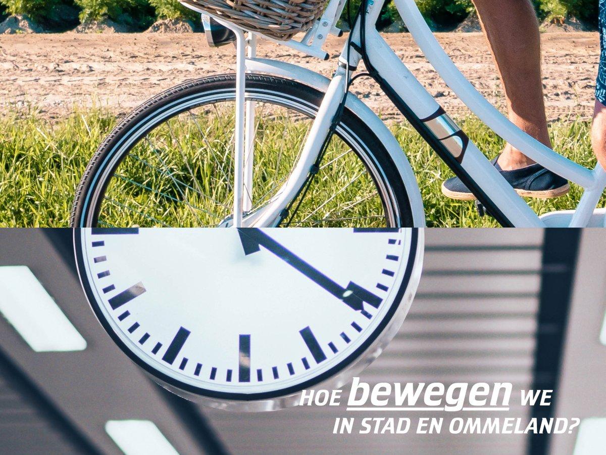 Foto van fietswiel waarbij de onderste helft van het wiel een klok is
